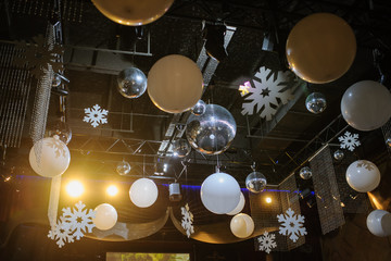Party disco decorations with lights and christmass balls on the ceiling