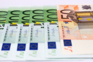 Money is a symbol of material wealth. European Union currency protection and recognition signs in close up view.