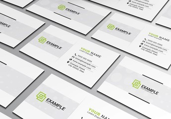 Business Card Layout with Green Accents