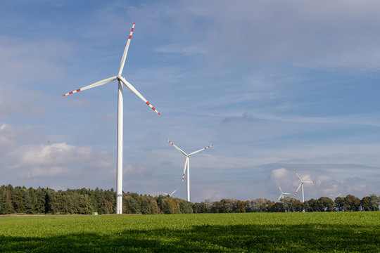 Wind farm on an open field. A windmill that generates electricity in central europe.