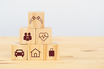 insurance concept, wooden cube symbolize put the insurance to protect or cover person, Property ,Liability, reliability,car, life, business, health, house, legal expenses, travel