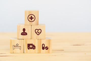 smart health care, insurance concept, wooden cube symbolize insurance to protect or cover person, Property ,Liability, reliability,car, life, business, health, house, legal expenses, travel
