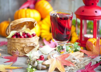 hot winter or autumn drink with spices and wild rose berries, mulled wine, hot wine