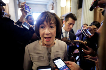 U.S. Senator Collins talks with reporters after announcing she will vote to confirm Supreme Court nominee Kavanaugh during speech on Senate floor on Capitol Hill in Washington