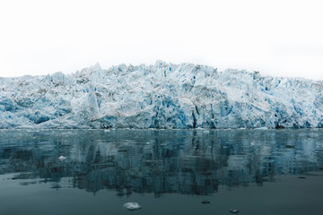 Iceberg reflecting in bay