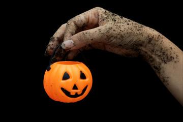 zombie Halloween hand and pumpkin