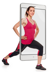 Young attractive fit woman in sportswear exercising on white background, concept virtual reality of the smartphone. going out of the device