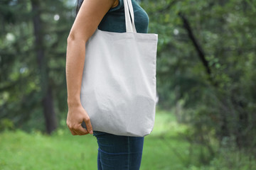 Woman with eco bag outdoors. Mockup for design