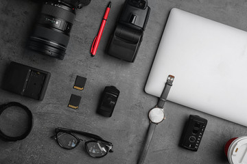 Flat lay composition with photographer's equipment and accessories on grey background