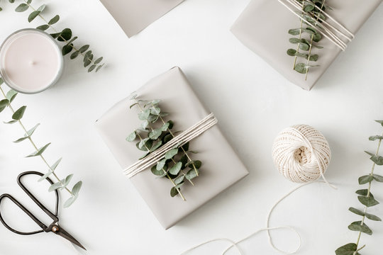 Gift box with minimalist style wrapping design. The concept of celebration events and wrapping gifts. Flat lay, top view.