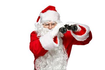 Santa Claus looking through binoculars. Isolate on white background.