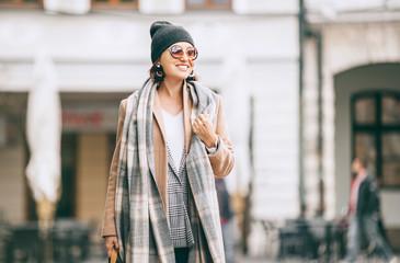 Wall Mural - Fashion weared woman walks on city street