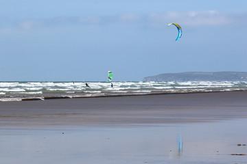 kitesurfers at Saunton Sands beach