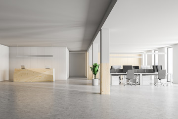 Wooden office reception desk and open space, front