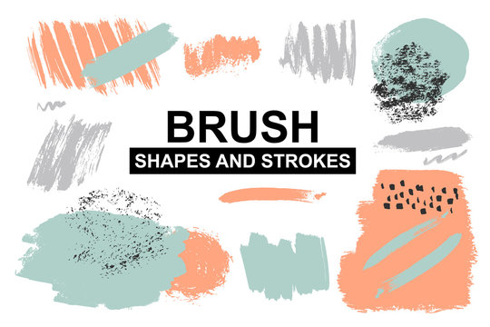 Set of painted brush shapes. Torn vector splashes.