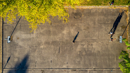 Top down view to basketball players, who plays streetball at old basketball court.
