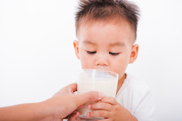 Asian portrait child boys 1 year 6 months drinking milk on glass