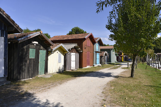 Wooden houses at ostreicole harbor of Biganos, commune is a located on the shore of Arcachon Bay, in the Gironde department in southwestern France.