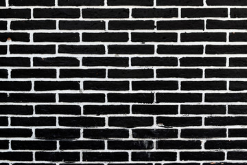 Black brick wall of dark texture. background with vignette corners. for interior or design