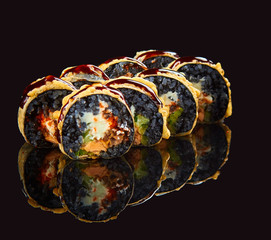 Sushi on a black background with mirror reflection