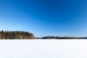Frozen lake under deep blue sky