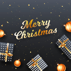 Merry Christmas template or greeting card design, top view of gift boxes and baubles on black background.