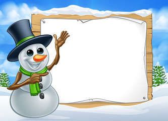 A snowman Christmas cartoon character wearing a top hat in a winter scene pointing at a sign