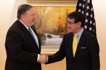 U.S. Secretary of State Mike Pompeo shakes hands with Japan's Foreign Minister Taro Kono before a meeting in Tokyo