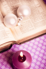Wall Mural - open bibble with Christmas decorative balls and candle Christian Catholic Christmas