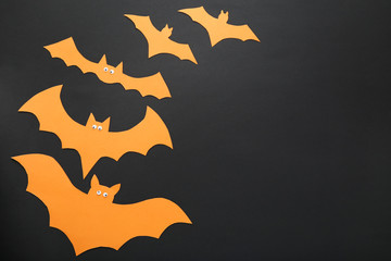 Paper halloween bats on black background