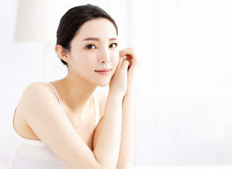 Beautiful young woman with clean perfect skin
