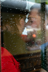 Sexy couple kissing and holding each other passionately in phone box