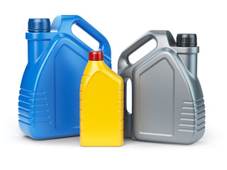 Different types of plastic canisters of motor oil on white isolated background.