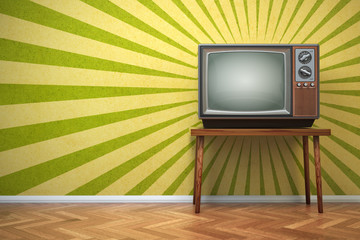 Retro old TV set on the vintage background.