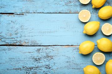 Ripe lemons on blue wooden table