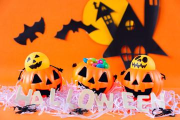 Halloween Jack o Lantern bucket with haunted house castle on yellow background