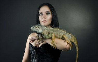 perfect portrait sensual girl and iguana in the studio