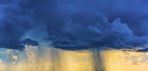 Fotobehang - Shower rain at sunset