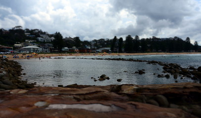 Avoca beach on a cloudy day in Autumn time. People can enjoy swimming, surfing, sunbathing and relaxing at Avoca beach.