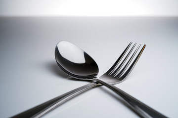 Fork & Spoon Kitchen Utensils fine art abstract on white isolated background