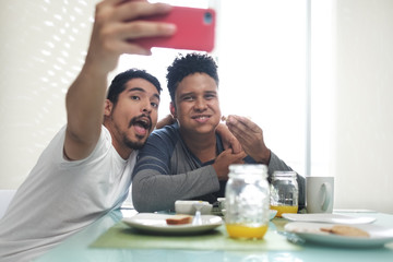 Gay Couple Eating Breakfast Taking Selfie With Phone