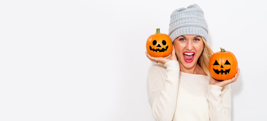 Young woman holding pumpkins on a white background Wall mural
