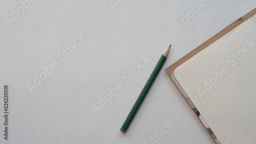 Wall mural notebook and pencil  business concept white background