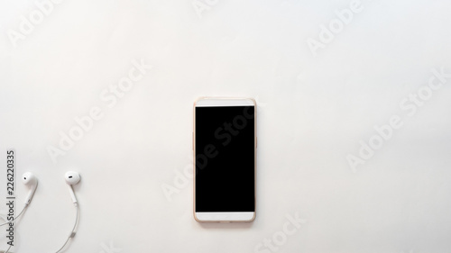 Wall mural smartphone and earphone business concept white background