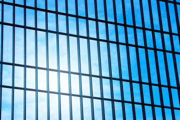 low angle view to glass window of modern skyscraper. business concept of success industry in architecture