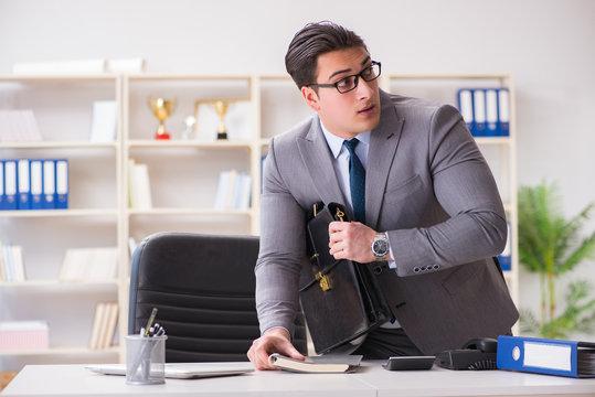 Businessman in industrial espionage concept