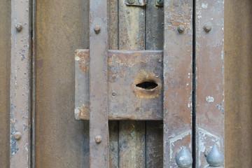Closeup no lock rusty metal foldable door