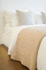 Comfortable bed in modern bedroom interior