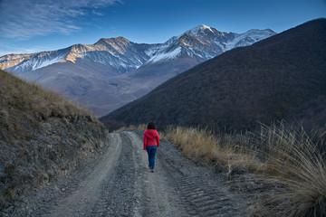 Woman tourist goes to the mountains.
