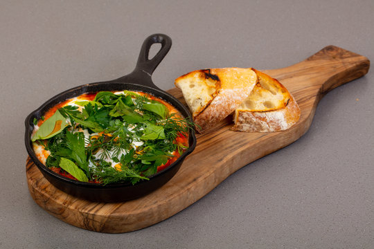 Traditional shakshouka with herbs